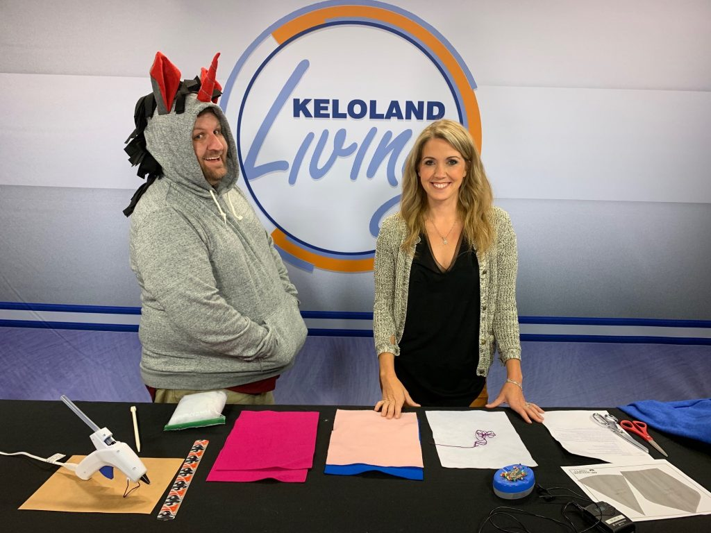 Jake on the set of KELOLAND Living, with Ashley Thompson. Jake is wearing a unicorn hoodie.